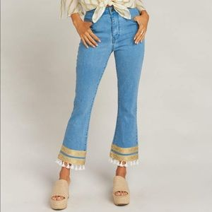Show Me Your MuMu tassel bottom flare jeans